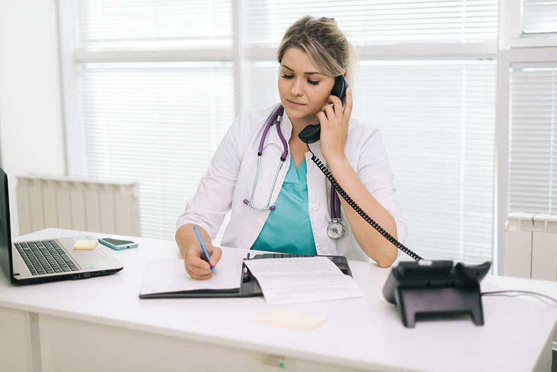 Doctor Answering Call Focusgroup