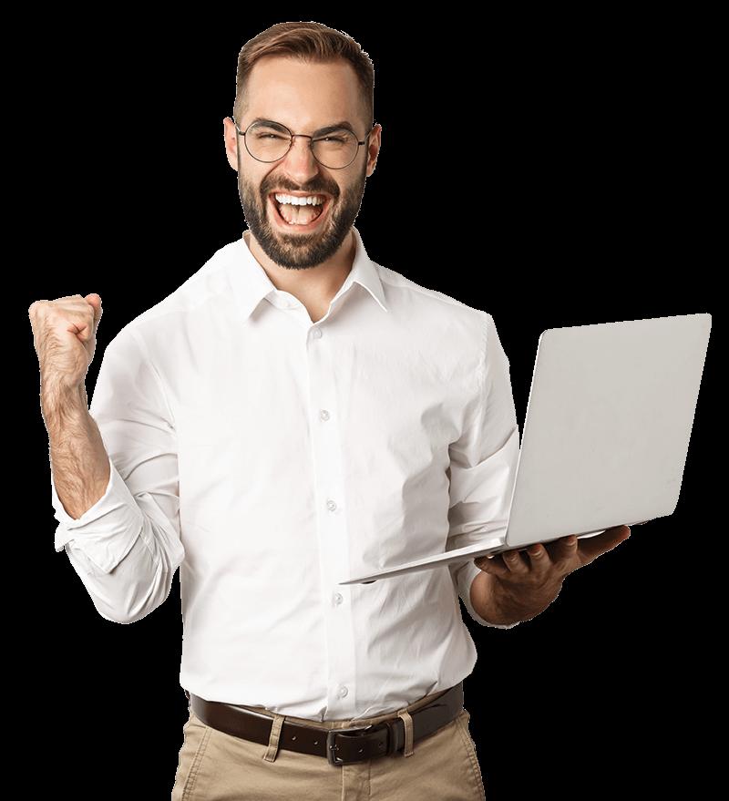 Man in white shirt celebrating with laptop